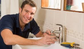 man fixing tap